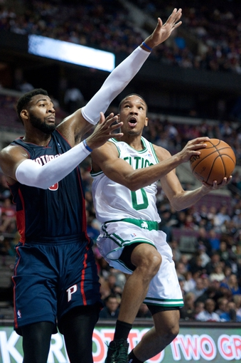 Nov 3, 2013; Auburn Hills, MI, USA; Detroit Pistons center Andre Drummond (0) guards Boston Celtics point guard Avery Bradley (0) during the second quarter at The Palace of Auburn Hills. Mandatory Credit: Tim Fuller-USA TODAY Sports