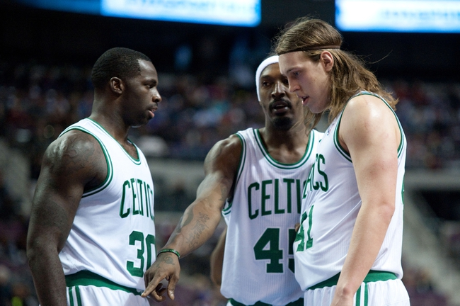 Nov 3, 2013; Auburn Hills, MI, USA; Boston Celtics small forward Gerald Wallace (45) talks to power forward Brandon Bass (30) and power forward Kelly Olynyk (41) during the second quarter against the Detroit Pistons at The Palace of Auburn Hills. Mandatory Credit: Tim Fuller-USA TODAY Sports