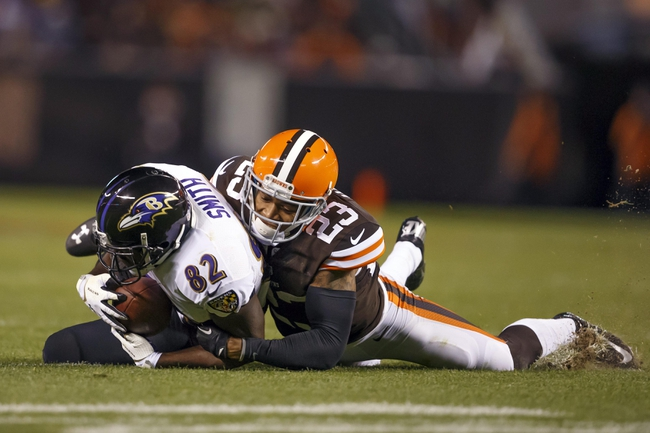 Nov 3, 2013; Cleveland, OH, USA; Baltimore Ravens wide receiver Torrey Smith (82) is tackled by Cleveland Browns cornerback Joe Haden (23) in the fourth quarter at FirstEnergy Stadium. Mandatory Credit: Rick Osentoski-USA TODAY Sports
