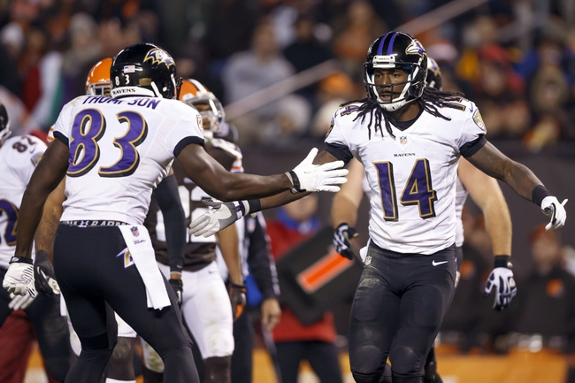 Nov 3, 2013; Cleveland, OH, USA; Baltimore Ravens wide receiver Deonte Thompson (83) congratulates wide receiver Marlon Brown (14) on touchdown in the fourth quarter at FirstEnergy Stadium. Mandatory Credit: Rick Osentoski-USA TODAY Sports