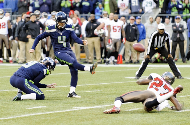 Nov 3, 2013; Seattle, WA, USA; Seattle Seahawks kicker Steven Hauschka (4) kicks the game winning field goal during overtime against the Tampa Bay Buccaneers at CenturyLink Field. Seattle defeated Tampa Bay 27-24. Mandatory Credit: Steven Bisig-USA TODAY Sports