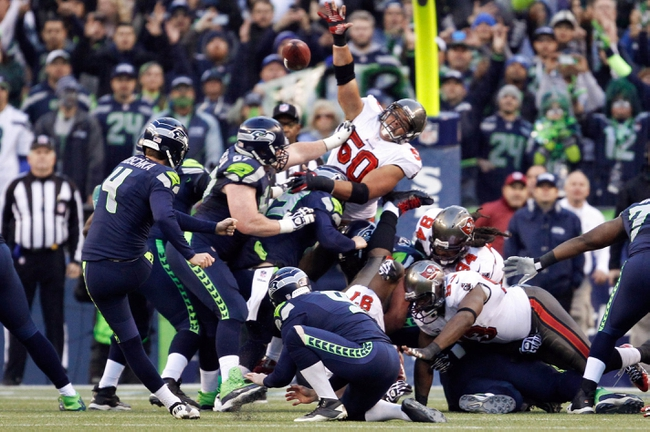 Nov 3, 2013; Seattle, WA, USA; Seattle Seahawks kicker Steven Hauschka (4) makes a game-winning 27-yard field goal against the Tampa Bay Buccaneers during overtime at CenturyLink Field. Seattle defeated Tampa Bay, 27-24. Mandatory Credit: Joe Nicholson-USA TODAY Sports