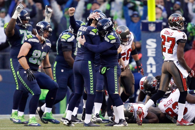 Nov 3, 2013; Seattle, WA, USA; Seattle Seahawks kicker Steven Hauschka (4) is embraced by holder Jon Ryan (9) after making a game-winning 27-yard field goal against the Tampa Bay Buccaneers during overtime at CenturyLink Field. Seattle defeated Tampa Bay, 27-24. Mandatory Credit: Joe Nicholson-USA TODAY Sports