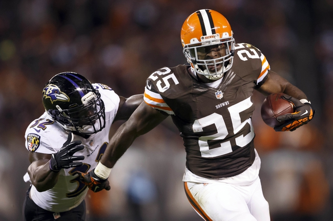 Nov 3, 2013; Cleveland, OH, USA; Cleveland Browns running back Chris Ogbonnaya (25) runs the ball past Baltimore Ravens strong safety James Ihedigbo (32) in the fourth quarter at FirstEnergy Stadium. Cleveland won 18-24. Mandatory Credit: Rick Osentoski-USA TODAY Sports