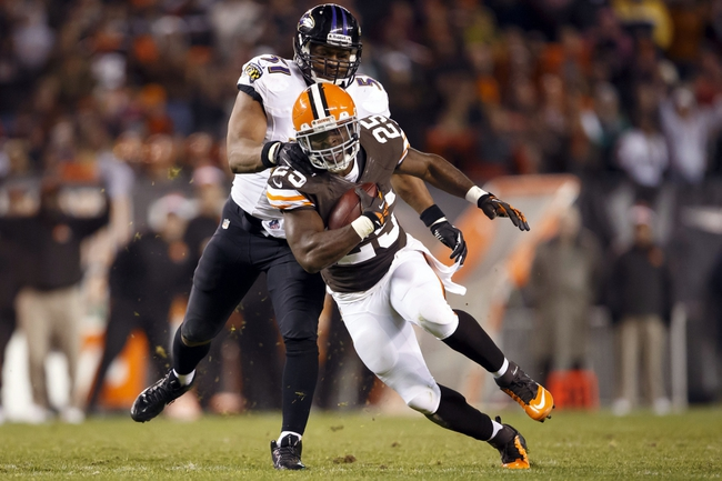Nov 3, 2013; Cleveland, OH, USA; Cleveland Browns running back Chris Ogbonnaya (25) runs the ball as Baltimore Ravens inside linebacker Daryl Smith (51) grabs him for the tackle in the fourth quarter at FirstEnergy Stadium. Cleveland won 18-24. Mandatory Credit: Rick Osentoski-USA TODAY Sports