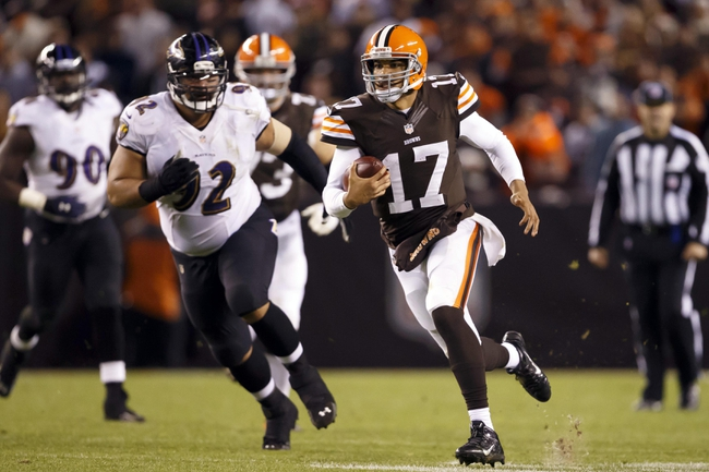 Nov 3, 2013; Cleveland, OH, USA; Cleveland Browns quarterback Jason Campbell (17) runs the ball in the fourth quarter against the Baltimore Ravens at FirstEnergy Stadium. Cleveland won 18-24. Mandatory Credit: Rick Osentoski-USA TODAY Sports