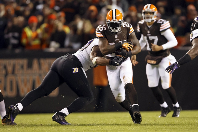 Nov 3, 2013; Cleveland, OH, USA; Cleveland Browns running back Willis McGahee (26) breaks a tackle by Baltimore Ravens defensive end Chris Canty (99) in the fourth quarter as at FirstEnergy Stadium. Cleveland won 18-24. Mandatory Credit: Rick Osentoski-USA TODAY Sports