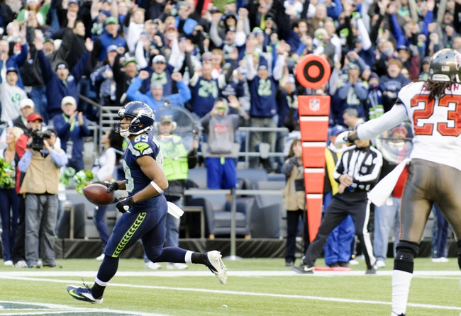 Nov 3, 2013; Seattle, WA, USA; Seattle Seahawks wide receiver Doug Baldwin (89) scores a touchdown against the Tampa Bay Buccaneers during the 2nd half at CenturyLink Field. Seattle defeated Tampa Bay 27-24. Mandatory Credit: Steven Bisig-USA TODAY Sports