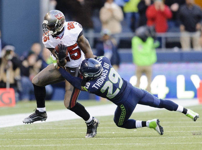 Nov 3, 2013; Seattle, WA, USA; Seattle Seahawks free safety Earl Thomas (29) tackles Tampa Bay Buccaneers running back Mike James (25) during the 2nd half at CenturyLink Field. Seattle defeated Tampa Bay 27-24. Mandatory Credit: Steven Bisig-USA TODAY Sports