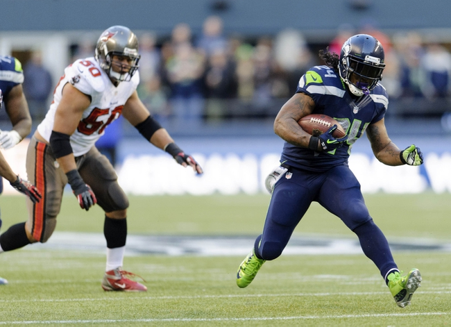 Nov 3, 2013; Seattle, WA, USA; Seattle Seahawks running back Marshawn Lynch (24) carries the ball against the Tampa Bay Buccaneers during the 2nd half at CenturyLink Field. Seattle defeated Tampa Bay 27-24. Mandatory Credit: Steven Bisig-USA TODAY Sports