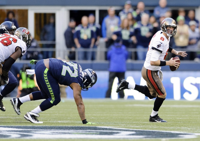 Nov 3, 2013; Seattle, WA, USA; Tampa Bay Buccaneers quarterback Mike Glennon (8) rolls out with the ball during the 2nd half against the Seattle Seahawks at CenturyLink Field. Seattle defeated Tampa Bay 27-24. Mandatory Credit: Steven Bisig-USA TODAY Sports