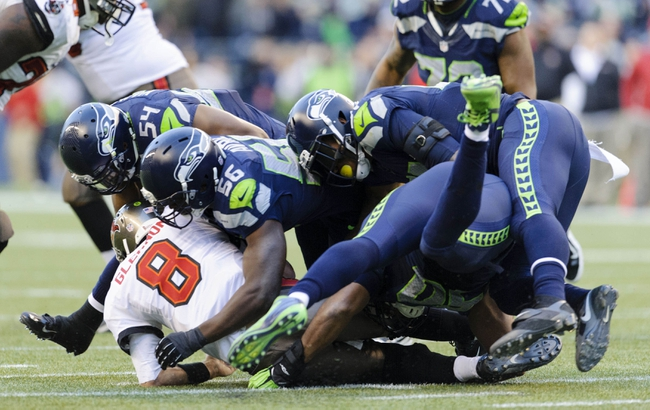 Nov 3, 2013; Seattle, WA, USA; Tampa Bay Buccaneers quarterback Mike Glennon (8) is sacked by the Seattle Seahawks defenders during the 2nd half at CenturyLink Field. Seattle defeated Tampa Bay 27-24. Mandatory Credit: Steven Bisig-USA TODAY Sports