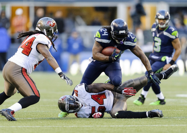 xNov 3, 2013; Seattle, WA, USA; Seattle Seahawks running back Marshawn Lynch (24) breaks a tackle attempt by Tampa Bay Buccaneers outside linebacker Lavonte David (54) during the 2nd half at CenturyLink Field. Seattle defeated Tampa Bay 27-24. Mandatory Credit: Steven Bisig-USA TODAY Sports