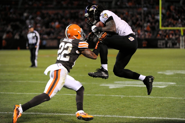 Nov 3, 2013; Cleveland, OH, USA; Baltimore Ravens wide receiver Marlon Brown (14) catches a touchdown ahead of the defense of Cleveland Browns cornerback Buster Skrine (22) during the fourth quarter at FirstEnergy Stadium. The Browns beat the Ravens 24-18. Mandatory Credit: Ken Blaze-USA TODAY Sports