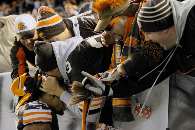 Nov 3, 2013; Cleveland, OH, USA; Cleveland Browns cornerback Joe Haden (23) gets a kiss on the head from a Browns fan after the Browns beat the Baltimore Ravens 24-18 at FirstEnergy Stadium. Mandatory Credit: Ken Blaze-USA TODAY Sports