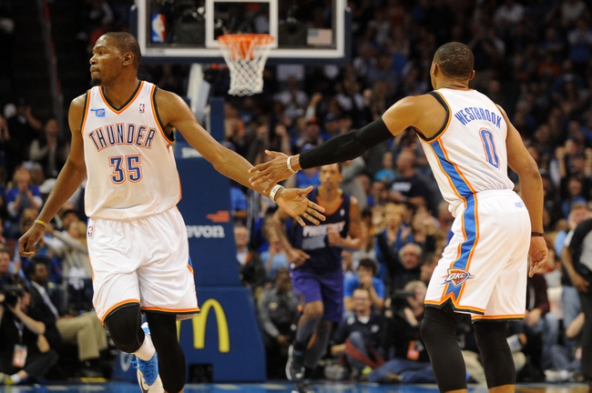 Nov 3, 2013; Oklahoma City, OK, USA; Oklahoma City Thunder small forward Kevin Durant (35) congratulates Oklahoma City Thunder point guard Russell Westbrook (0) after a play against the Phoenix Suns during the second quarter at Chesapeake Energy Arena. Mandatory Credit: Mark D. Smith-USA TODAY Sports