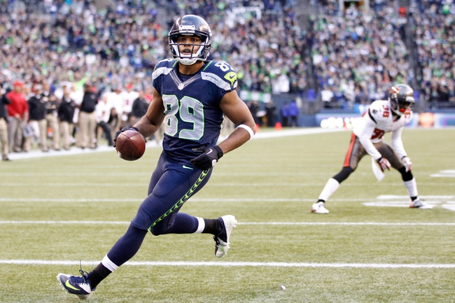 Nov 3, 2013; Seattle, WA, USA; Seattle Seahawks wide receiver Doug Baldwin (89) runs into the end zone for a touchdown against the Tampa Bay Buccaneers during the fourth quarter at CenturyLink Field. Mandatory Credit: Joe Nicholson-USA TODAY Sports