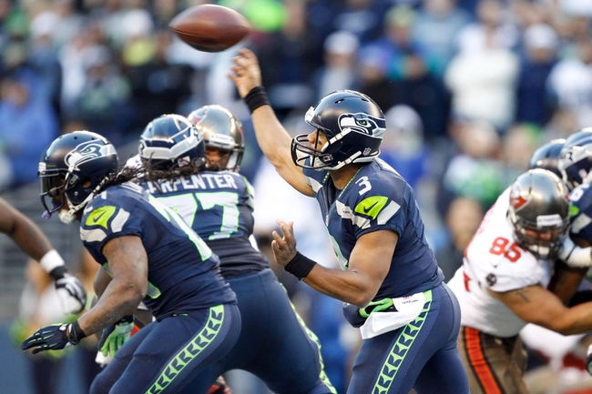Nov 3, 2013; Seattle, WA, USA; Seattle Seahawks quarterback Russell Wilson (3) passes against the Tampa Bay Buccaneers during the second half at CenturyLink Field. Mandatory Credit: Joe Nicholson-USA TODAY Sports
