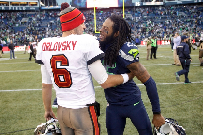 Nov 3, 2013; Seattle, WA, USA; Seattle Seahawks cornerback Richard Sherman (25) greets Tampa Bay Buccaneers quarterback Dan Orlovsky (6) following a 27-24 overtime victory by Seattle at CenturyLink Field. Mandatory Credit: Joe Nicholson-USA TODAY Sports