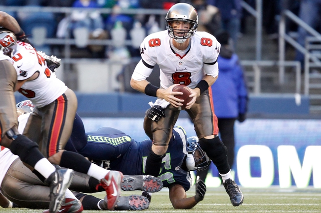 Nov 3, 2013; Seattle, WA, USA; Tampa Bay Buccaneers quarterback Mike Glennon (8) is pressured by Seattle Seahawks defensive end Cliff Avril (56) during overtime at CenturyLink Field. Mandatory Credit: Joe Nicholson-USA TODAY Sports