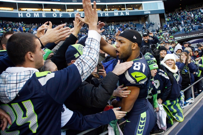 Nov 3, 2013; Seattle, WA, USA; Seattle Seahawks wide receiver Golden Tate (81) celebrates with fans following a 27-24 overtime victory against the Tampa Bay Buccaneers at CenturyLink Field. Mandatory Credit: Joe Nicholson-USA TODAY Sports