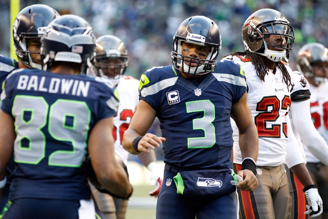Nov 3, 2013; Seattle, WA, USA; Seattle Seahawks quarterback Russell Wilson (3) greets wide receiver Doug Baldwin (89) following a touchdown pass against the Tampa Bay Buccaneers during the fourth quarter at CenturyLink Field. Mandatory Credit: Joe Nicholson-USA TODAY Sports