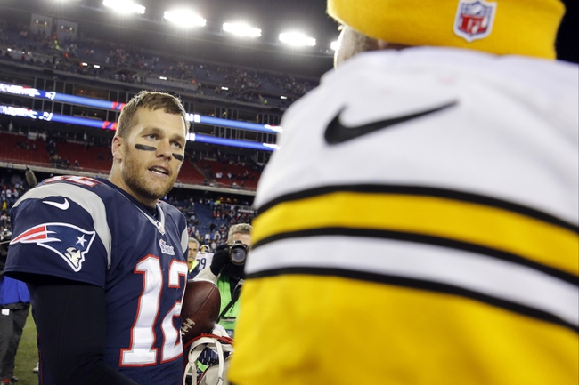 Nov 3, 2013; Foxborough, MA, USA; New England Patriots quarterback Tom Brady (12) greets Pittsburgh Steelers quarterback Ben Roethlisberger (7) after the game at Gillette Stadium. The Patriots defeated the Steelers 55-31. Mandatory Credit: David Butler II-USA TODAY Sports