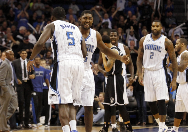 Nov 3, 2013; Orlando, FL, USA; Orlando Magic shooting guard Victor Oladipo (5) is congratulated by Orlando Magic shooting guard E'Twaun Moore (55) after he slam dunked against the Brooklyn Nets during the second half at Amway Center. Orlando Magic defeated the Brooklyn Nets 107-86. Mandatory Credit: Kim Klement-USA TODAY Sports