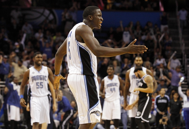 Nov 3, 2013; Orlando, FL, USA; Orlando Magic shooting guard Victor Oladipo (5) reacts after a dunk against the Brooklyn Nets during the second half at Amway Center. Orlando Magic defeated the Brooklyn Nets 107-86. Mandatory Credit: Kim Klement-USA TODAY Sports