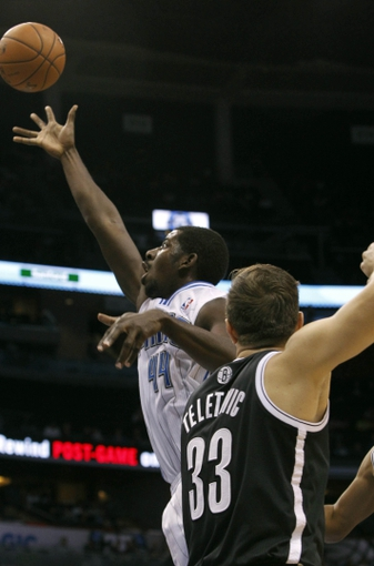 Nov 3, 2013; Orlando, FL, USA; Orlando Magic power forward Andrew Nicholson (44) shoots as Brooklyn Nets power forward Mirza Teletovic (33) attempts to defend during the second half at Amway Center. Orlando Magic defeated the Brooklyn Nets 107-86. Mandatory Credit: Kim Klement-USA TODAY Sports