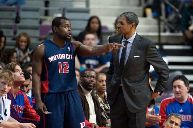 Nov 3, 2013; Auburn Hills, MI, USA; Detroit Pistons head coach Maurice Cheeks listens to point guard Will Bynum (12) during the third quarter against the Boston Celtics at The Palace of Auburn Hills. Detroit won 87-77. Mandatory Credit: Tim Fuller-USA TODAY Sports
