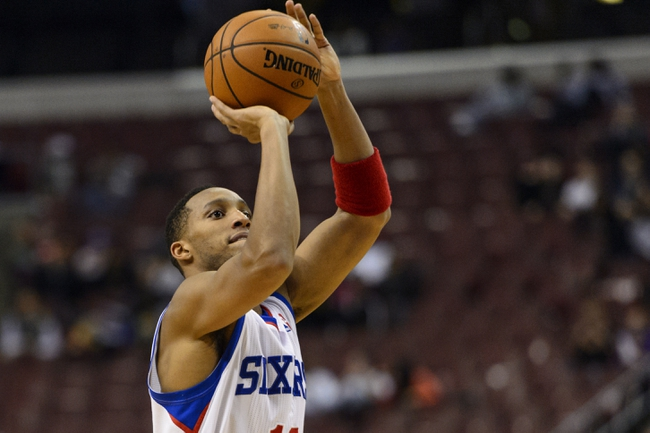 Oct 23, 2013; Philadelphia, PA, USA; Philadelphia 76ers guard Evan Turner (12) shoots a jump shot during the third quarter against the Minnesota Timberwolves at Wells Fargo Center. The Timberwolves defeated the Sixers 125-102. Mandatory Credit: Howard Smith-USA TODAY Sports
