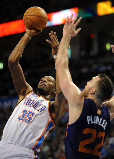 Nov 3, 2013; Oklahoma City, OK, USA; Oklahoma City Thunder small forward Kevin Durant (35) attempts a shot against Phoenix Suns power forward Miles Plumlee (22) during the fourth quarter at Chesapeake Energy Arena. Mandatory Credit: Mark D. Smith-USA TODAY Sports