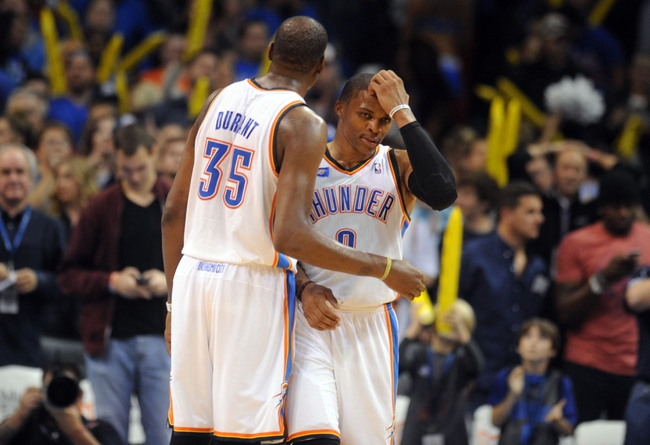Nov 3, 2013; Oklahoma City, OK, USA; Oklahoma City Thunder small forward Kevin Durant (35) and Thunder point guard Russell Westbrook (0) react to a play in action against the Phoenix Suns during the fourth quarter at Chesapeake Energy Arena. Mandatory Credit: Mark D. Smith-USA TODAY Sports