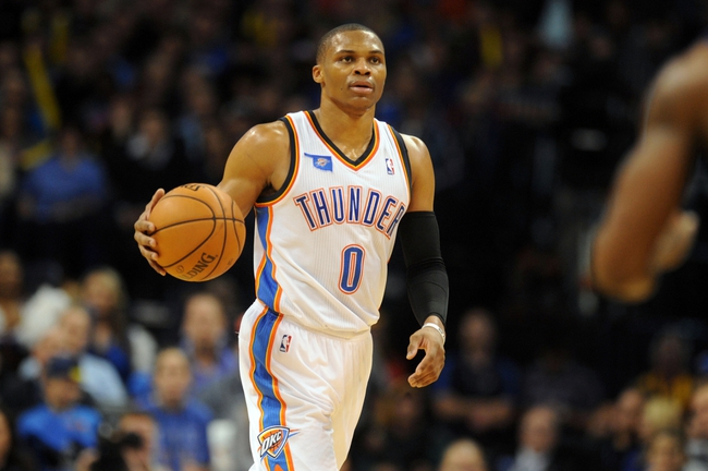 Nov 3, 2013; Oklahoma City, OK, USA; Oklahoma City Thunder point guard Russell Westbrook (0) handles the ball in action against the Phoenix Suns during the fourth quarter at Chesapeake Energy Arena. Mandatory Credit: Mark D. Smith-USA TODAY Sports
