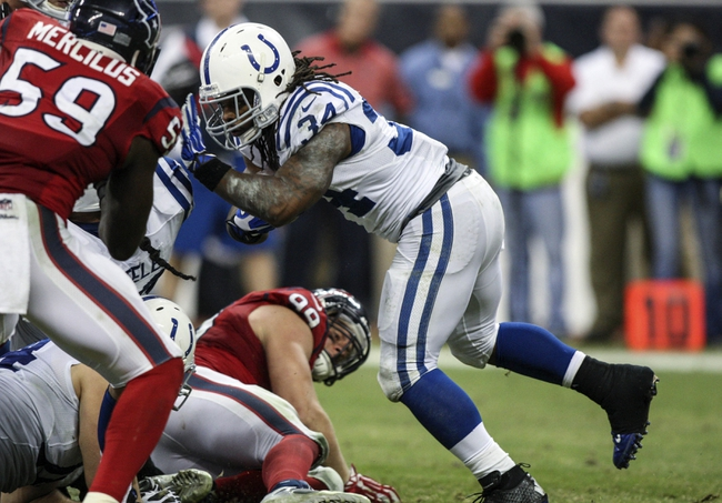 Nov 3, 2013; Houston, TX, USA; Indianapolis Colts running back Trent Richardson (34) rushes during the fourth quarter against the Houston Texans at Reliant Stadium. The Colts defeated the Texans 27-24. Mandatory Credit: Troy Taormina-USA TODAY Sports