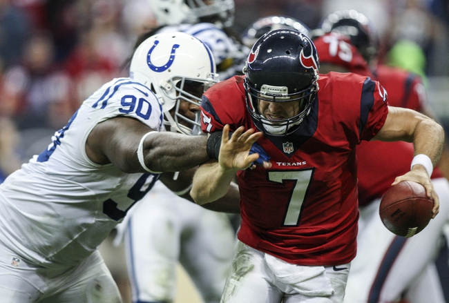 Nov 3, 2013; Houston, TX, USA; Houston Texans quarterback Case Keenum (7) runs with the ball during the third quarter as Indianapolis Colts defensive end Cory Redding (90) pursues at Reliant Stadium. The Colts defeated the Texans 27-24. Mandatory Credit: Troy Taormina-USA TODAY Sports