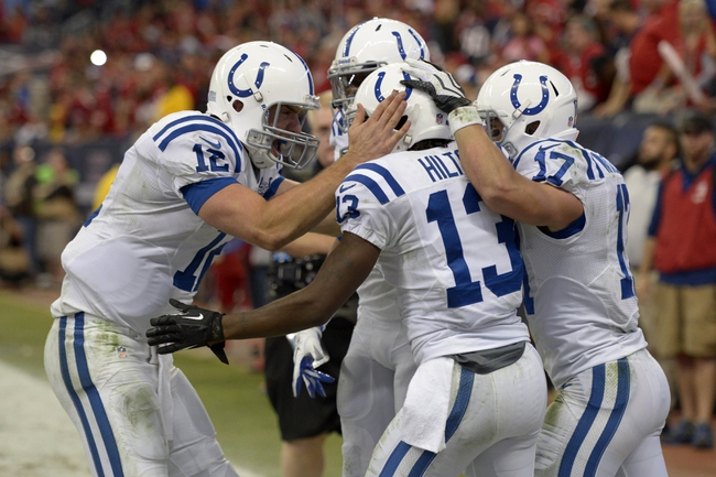 Nov 3, 2013; Houston, TX, USA; Indianapolis Colts quarterback Andrew Luck (12) celebrates throwing a touchdown to wide receiver T.Y. Hilton (13) against the Houston Texans during the second half at Reliant Stadium. The Colts won 27-24. Mandatory Credit: Thomas Campbell-USA TODAY Sports