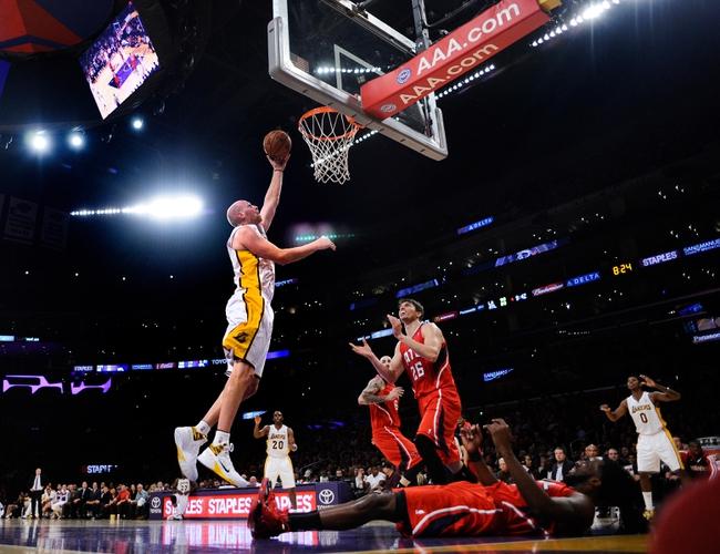 Nov 3, 2013; Los Angeles, CA, USA; Los Angeles Lakers center Chris Kaman (9) puts up a shot during the second half against the Atlanta Hawks at Staples Center. Mandatory Credit: Robert Hanashiro-USA TODAY Sports