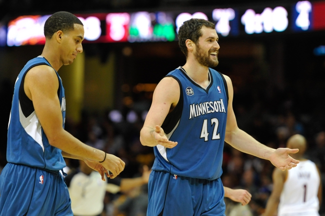 Nov 4, 2013; Cleveland, OH, USA; Minnesota Timberwolves shooting guard Kevin Martin (left) and power forward Kevin Love (42) react in the fourth quarter against the Cleveland Cavaliers at Quicken Loans Arena. Mandatory Credit: David Richard-USA TODAY Sports