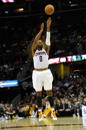 Nov 4, 2013; Cleveland, OH, USA; Cleveland Cavaliers shooting guard C.J. Miles makes a three-point shot in the fourth quarter against the Minnesota Timberwolves at Quicken Loans Arena. Mandatory Credit: David Richard-USA TODAY Sports