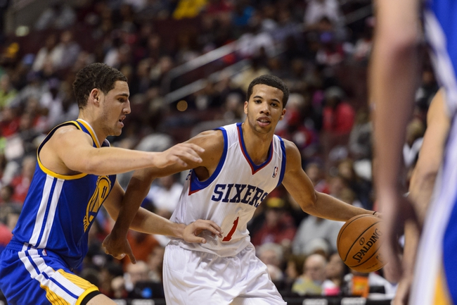 Nov 4, 2013; Philadelphia, PA, USA; Philadelphia 76ers guard Michael Carter-Williams (1) is defended by Golden State Warriors guard Klay Thompson (11) during the third quarter at Wells Fargo Center. The Warriors defeated the Sixers 110-90. Mandatory Credit: Howard Smith-USA TODAY Sports