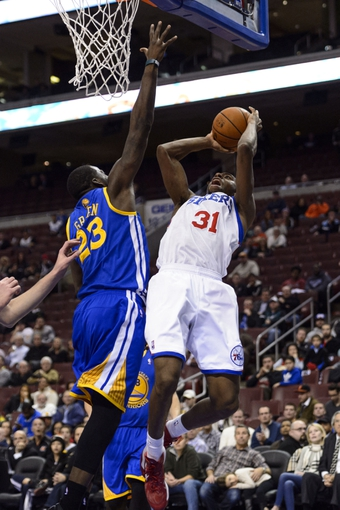 Nov 4, 2013; Philadelphia, PA, USA; Philadelphia 76ers forward Hollis Thompson (31) shoots under pressure from Golden State Warriors forward Draymond Green (23) during the fourth quarter at Wells Fargo Center. The Warriors defeated the Sixers 110-90. Mandatory Credit: Howard Smith-USA TODAY Sports
