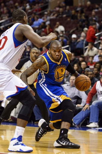 Nov 4, 2013; Philadelphia, PA, USA; Golden State Warriors forward Marreese Speights (5) is defended by Philadelphia 76ers center Lavoy Allen (50) during the fourth quarter at Wells Fargo Center. The Warriors defeated the Sixers 110-90. Mandatory Credit: Howard Smith-USA TODAY Sports