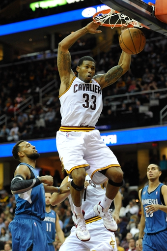 Nov 4, 2013; Cleveland, OH, USA; Cleveland Cavaliers small forward Alonzo Gee (33) dunks in the fourth quarter against the Minnesota Timberwolves at Quicken Loans Arena. Mandatory Credit: David Richard-USA TODAY Sports