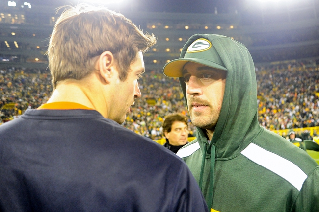 Nov 4, 2013; Green Bay, WI, USA;   Green Bay Packers quarterback Aaron Rodgers (right) talks to Chicago Bears quarterback Jay Cutler (left) after the Bears beat the Packers 27-20 at Lambeau Field. Rodgers left the game early in the 1st quarter with a left shoulder injury.  Mandatory Credit: Benny Sieu-USA TODAY Sports