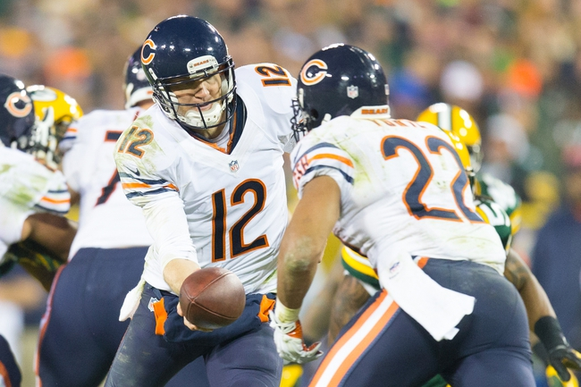 Nov 4, 2013; Green Bay, WI, USA; Chicago Bears quarterback Josh McCown (12) hands the football to running back Matt Forte (22) during the fourth quarter against the Green Bay Packers at Lambeau Field. Chicago won 27-20.  Mandatory Credit: Jeff Hanisch-USA TODAY Sports