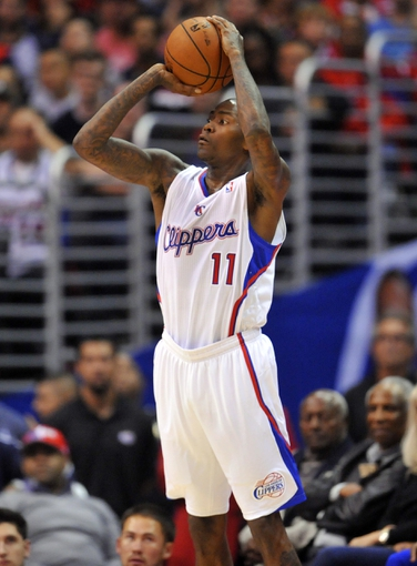 November 4, 2013; Los Angeles, CA, USA; Los Angeles Clippers shooting guard Jamal Crawford (11) shoots a three point basket against Houston Rockets during the first half at Staples Center. Mandatory Credit: Gary A. Vasquez-USA TODAY Sports