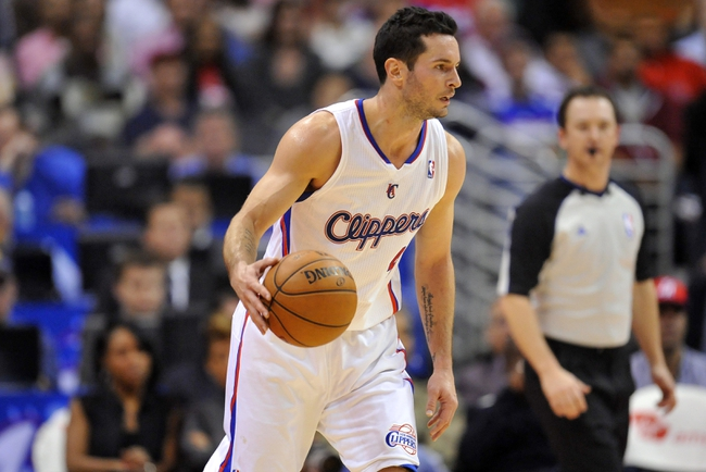 November 4, 2013; Los Angeles, CA, USA; Los Angeles Clippers shooting guard J.J. Redick (4) controls the ball against Houston Rockets during the first half at Staples Center. Mandatory Credit: Gary A. Vasquez-USA TODAY Sports