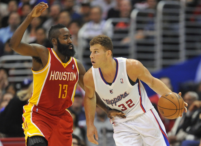November 4, 2013; Los Angeles, CA, USA; Los Angeles Clippers power forward Blake Griffin (32) moves the ball against the defense of Houston Rockets shooting guard James Harden (13) during the first half at Staples Center. Mandatory Credit: Gary A. Vasquez-USA TODAY Sports